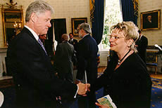 President Clinton greets Joan Echtenkamp Klein. Photo courtesy of the White House
