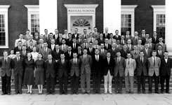 The medical school class of 1959 gathers on the steps of the Medical School.