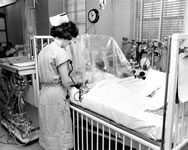 A nurse observes a patient under an oxygen tent. & History of the University of Virginia Hospital in the 1950s and ...