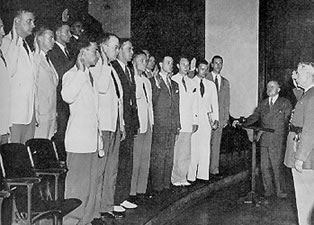 Fourteen graduates of the Class of 1941 take the oath of office as first lieutenants in the Medical Corps Reserve of the United States Army