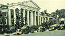Cars parked infront of the portico entrance to the Medical School