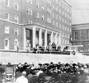 New hospital completed April 14, 1961, providing 682 beds and bassinets