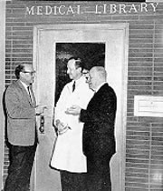 Drs. Wilhelm Moll, Albert J Paquin, Jr., and James E Kindred in front of the old Medical Library