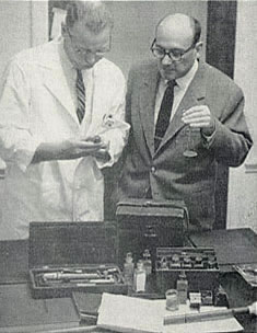 Dr. R.H. Gourley, pharmacology professor and Dr. Welhelm Moll, Medical Librarian, examine a one-hundred-year-old manuscript