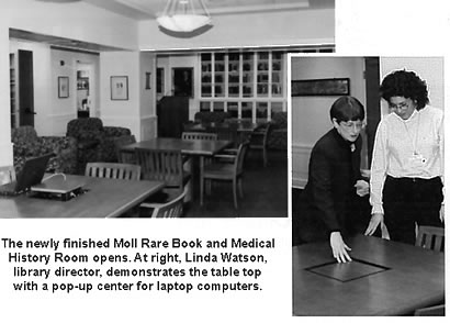The newly finished Moll Rare Book and Medical History Room opens. At right, Library Director Linda Watson demonstrates a table top's pop-up ethernet port for laptop computers