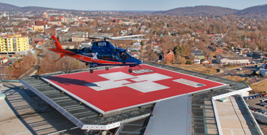 Pegasus emergency medical transport lands on top of the hospital.