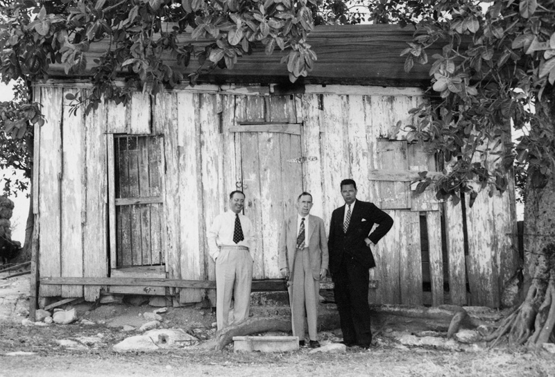 Pedro Nogueira, John J. Moran, Philip S. Hench (l.-r.) in front of Building Number One at the Camp Lazear site in Cuba, March 1948. Philip S. Hench Walter Reed Yellow Fever Collection 1806-1995, Box-folder 91:31. Historical Collections, Claude Moore Health Sciences Library, University of Virginia.