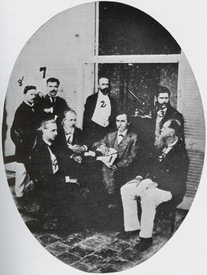 The Havana Yellow Fever Commission of the United States National Board of Health. This photograph was taken at the Commission's laboratory in Havana's Hotel San Carlos in August 1879. (Left to Right) Abraham Morejon, Assistant Medical Clerk; Colonel Thomas S. Hardee, Sanitary Engineer; Rudolph Matas, Medical Clerk; Henry C. Hall, U.S. Consul General at Havana; George M. Sternberg, Bacteriologist; Stanford E. Chaille, Chairman; Juan Guiteras, Pathologist; Daniel Burgess, U.S. Sanitary and Quarantine Inspector at Havana. Photograph taken from: Finl;ay, Carlos Eduardo. Carlos Finlay and Yellow Fever. 1940.